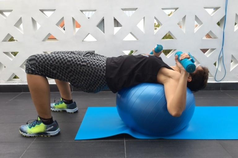 supine bridge on ball starting position